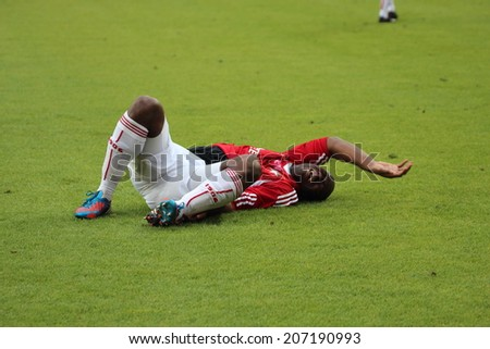KRAKOW, POLAND - October 6: Injured player during football match between Wisla Krakow and Legia Warsaw, on October 6, 2013 in Krakow, Poland.  - stock photo