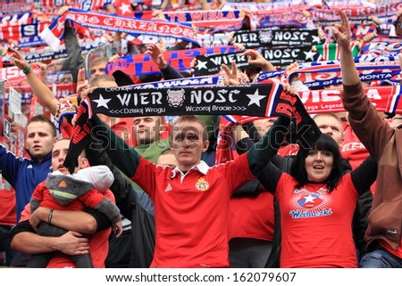 KRAKOW, POLAND - OCTOBER 6: Wisla Krakow fans during the football match between Wisla Krakow and Legia Warsaw, 1:1 on October 6, 2013 in Krakow, Poland.  - stock photo