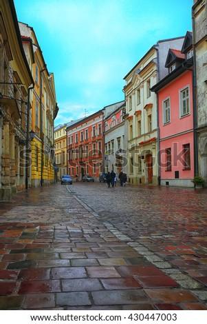 Krakow - Poland's historic center, a city with ancient architecture. Wet bricks - stock photo