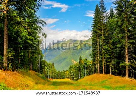 Krasnaya Polyana (Aibga ridge) on a sunny summer's day. Ski Resort, Sochi, Russia.  - stock photo