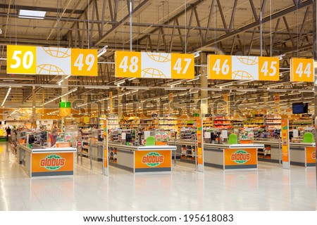 KRASNOGORSK, RUSSIA - MAY 17, 2014:  Checkout lane of Globus supermarket. The first Globus supermarket in Russia was opened in 2006. - stock photo