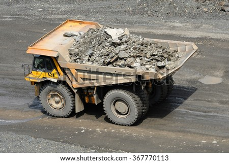 Kremenchug, Ukraine - June 26, 2010. Dump truck driving on a road in a stone quarry. - stock photo