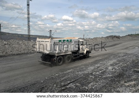 Kremenchug, Ukraine - June 26, 2010. Dump truck KrAZ driving on a road in a stone quarry. - stock photo