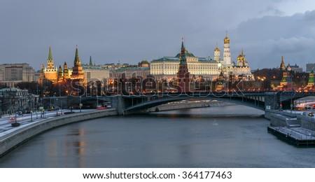 Kremlin embankment, Kremlin Wall, Grand Kremlin Palace. Bolshoy Kamenny Bridge. Morning blue hour winter shot. Stunning panoramic view. Moscow Russia - stock photo