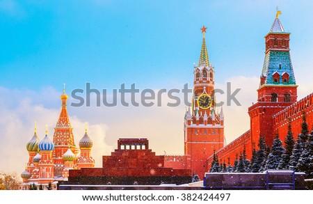 Kremlin wall Spasskaya Tower Mausoleum Red Square sunset winter - stock photo
