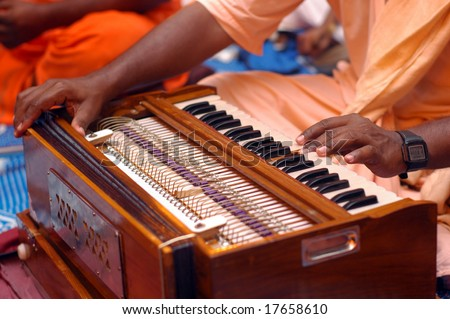 Krishna Devotee Playing Harmonium - stock photo
