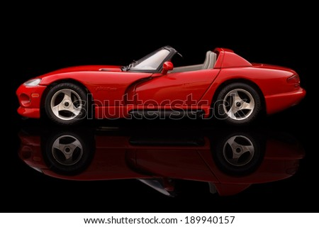 KRIVOY ROG, UKRAINE - APR 21- Toy dodge viper on black background, Monday 21 April 2014 - stock photo