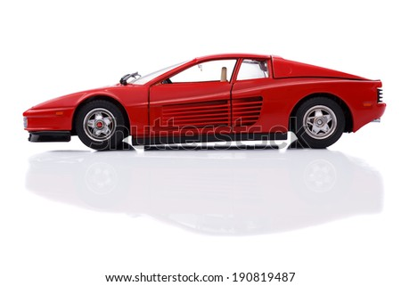 KRIVOY ROG, UKRAINE - APR 21- Toy ferrari testarossa 1984 on white background, Monday 21 April 2014 - stock photo