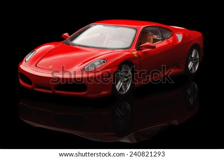 KRIVOY ROG, UKRAINE - DEC 25- Toy ferrari F430 on black background, Thursday 25 December 2014 - stock photo