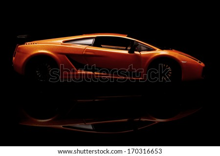 KRIVOY ROG, UKRAINE - JAN 04: Toy Lamborghini Gallardo on a black background. January 4, 2014. - stock photo