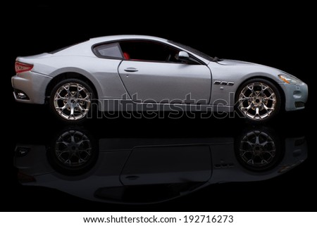 KRIVOY ROG, UKRAINE - JAN 04 - Toy maserati granturismo on black background, Saturday 4 January 2014 - stock photo