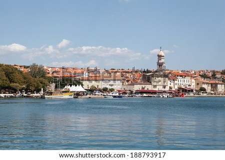 KRK, CROATIA - AUGUST 7, 2012: Town of Krk, main settlement of the Island of Krk in Croatia. The town has been inhabited since Roman times and is one of the oldest cities in the Adriatic.  - stock photo