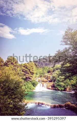 Krka river in Croatia and waterfalls in Krka National park. Toned image. - stock photo