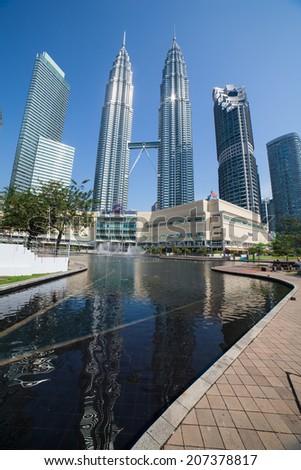 KUALA LUMPUR - APRIL 8: View of The Petronas Twin Towers on April 8,2014 in Kuala Lumpur, Malaysia. It is famous landmark of Malaysia. Petronas are the tallest twin buildings in the world (451.9 m).  - stock photo