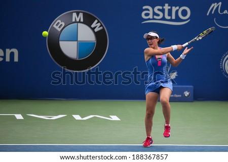 KUALA LUMPUR - APRIL 19, 2014: Zheng Saisai returns in the semifinals of the BMW Malaysian Open tennis in Kuala Lumpur, Malaysia. Partnering Chan YungJan, they beat Olga Savchuk and Lyudmyla Kichenok. - stock photo
