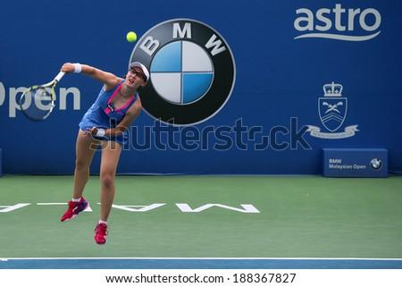 KUALA LUMPUR - APRIL 19, 2014: Zheng Saisai serves in the semifinals of the BMW Malaysian Open tennis in Kuala Lumpur, Malaysia. Partnering Chan YungJan, they beat Olga Savchuk and Lyudmyla Kichenok. - stock photo