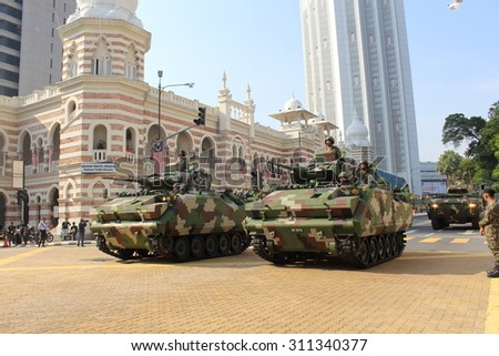 KUALA LUMPUR-Aug 28 : Armored Personnel Carrier (APC) Adnan cruise the road  during the rehearsal for National Day parade on Aug 28,2015 in front Textile Museum ,Dataran Merdeka, Kuala Lumpur,Malaysia - stock photo