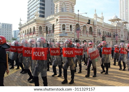 KUALA LUMPUR - Aug 28 : Federal Reserve Unit from Royal Malaysia Police (Polis Diraja Malaysia / PDRM) during rehearsal for National Day parade on Aug 28,2015 at Dataran Merdeka, Kuala Lumpur,Malaysia - stock photo