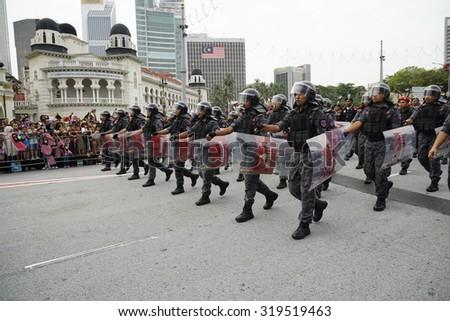 KUALA LUMPUR AUG 31:Federal Reserve Unit from Royal Malaysia Police (Polis Diraja Malaysia/PDRM) march during the Merdeka Daya celebration on August 31,2014 in Dataran Merdeka,Kuala Lumpur,Malaysia - stock photo