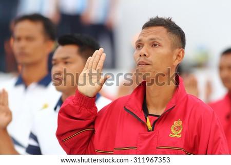 KUALA LUMPUR - Aug 27 : Unidentified men raise their hand for oath during the rehearsal for National Day parade on Aug 27,2015 at Bangunan Sultan Abdul Samad ,Dataran Merdeka, Kuala Lumpur, Malaysia - stock photo