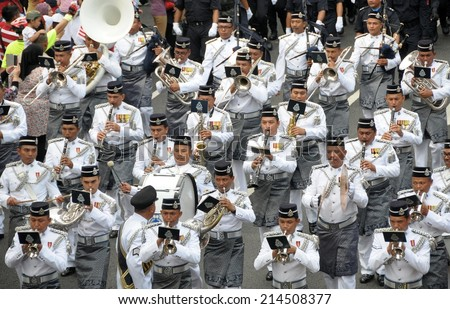 KUALA LUMPUR - AUGUST 31: Musical band from police department during 57th Celebrations, Malaysian Independence Day Parade on August 31, 2014 in Kuala Lumpur, Malaysia.  - stock photo