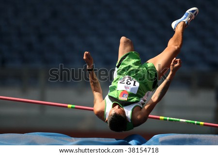 KUALA LUMPUR - AUGUST 16: Myanmar's amputee athlete fails in his attempt in the high jump event of the fifth ASEAN Para Games on August 16, 2009 in Kuala Lumpur. - stock photo