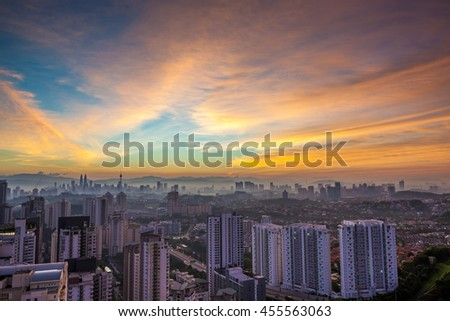 Kuala Lumpur cityscape at dawn with colorful cloudy sky, viewed from Mont Kiara, east of KL - stock photo