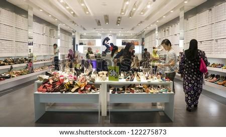 KUALA LUMPUR - DEC 19 : Shoe Stores in Jaya Jusco Wangsa Maju, Kuala Lumpur made sales during the festive Christmas day in Kuala Lumpur, Malaysia on Dec 19, 2012. - stock photo