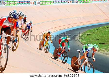 KUALA LUMPUR-FEB 11: Riders from various Asian countries participate in the track event during the Asian Cycling Championships 2012 at Kuala Lumpur Velodrome, Malaysia on February 11, 2012 - stock photo