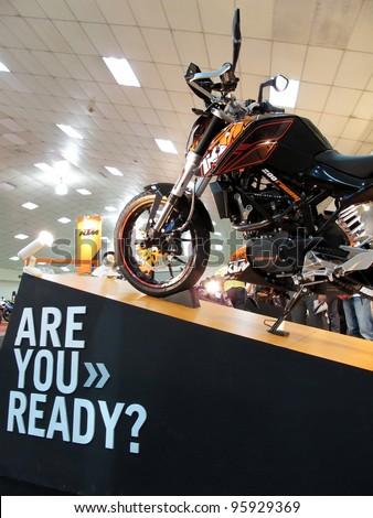 KUALA LUMPUR - FEBRUARY 23: A 2012 KTM DUKE 200 is on display during MotoXpo Show & Conference (MotoXpo KL 2012) on February 23, 2012 at the Putra World Trade Centre (PWTC) in Kuala Lumpur, Malaysia - stock photo