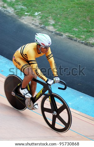 KUALA LUMPUR, FEBRUARY 12: Azizulhasni Awang from Malaysia finish second place in Keirin event during the Asian Cycling Championships 2012 at the Kuala Lumpur Velodrome, Malaysia on February 12, 2012 - stock photo
