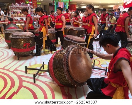 KUALA LUMPUR - FEBRUARY 14: Chinese lion dance troupe drum performance in celebration of upcoming Chinese New Year celebrations in Kuala Lumpur February 14, 2015 - stock photo