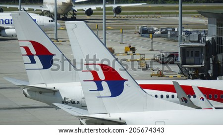 KUALA LUMPUR INTERNATIONAL AIRPORT - JULY 18, 2014: Malaysia Airlines aircraft tail logo at KLIA, Sepang, Malaysia. Malaysia Airlines MH17 crashes on Ukraine-Russia border today, killing 295 people - stock photo