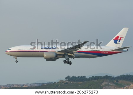 KUALA LUMPUR INTERNATIONAL AIRPORT (KLIA), SEPANG, MALAYSIA- JULY 21, 2014: Boeing 777-200ER (9M-MRB) MAS lands at KLIA, Malaysia. Similar plane MH17 was shot down in Ukraine-Russian border recently. - stock photo