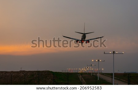 KUALA LUMPUR INTERNATIONAL AIRPORT (KLIA), SEPANG, MALAYSIA - JULY 24: Malaysia Airlines plane prepares for landing during sunset at KLIA airport on July 24, 2014 in KLIA, Sepang, Malaysia. - stock photo