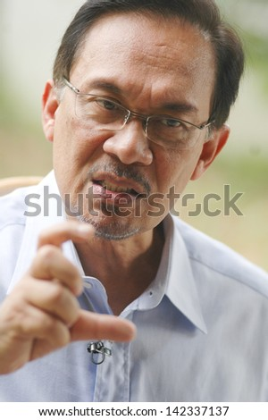 KUALA LUMPUR - JAN 20 : Malaysian opposition leader Anwar Ibrahim speaks during an interview with Press at his office in Kuala Lumpur on January 20, 2013 - stock photo