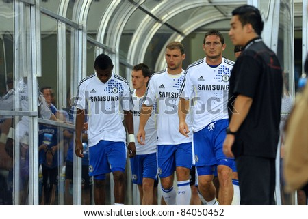 KUALA LUMPUR, JULY 21 : Chelsea players walked into the stadium during a preseason match against Malaysia on July 21, 2011 in Kuala Lumpur, Malaysia. Chelsea won 1-0 - stock photo
