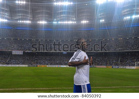 KUALA LUMPUR, JULY 21 : Chelsea's Didier Drogba, joking with friend during a preseason match against Malaysia on July 21, 2011 in Kuala Lumpur, Malaysia. Chelsea won 1-0 - stock photo