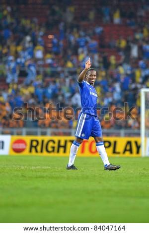 KUALA LUMPUR, July 21 : Chelsea's Didier Drogba waving hand during a preseason match agains Malaysia on July 21, 2011 in Kuala Lumpur, Malaysia. Chelsea won 1-0 - stock photo