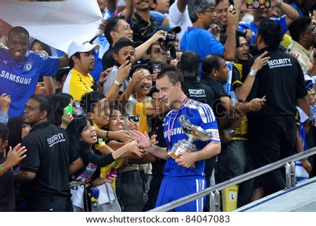 KUALA LUMPUR, July 21 : Chelsea's John Terry shaking hands with fans during a preseason match agains Malaysia on July 21, 2011 in Kuala Lumpur, Malaysia. Chelsea won 1-0 - stock photo