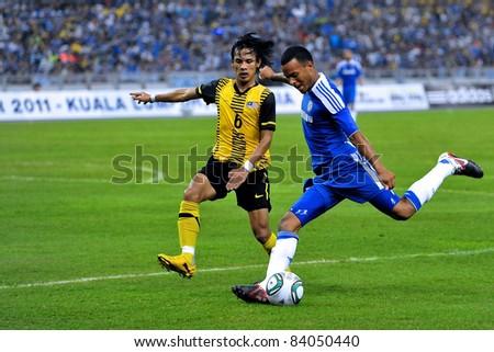 KUALA LUMPUR, JULY 21 : Chelsea's Jose Bosingwa and Shahrulnizam Mustapa, in action during a preseason match against Malaysia on July 21, 2011 in Kuala Lumpur, Malaysia. Chelsea won 1-0 - stock photo