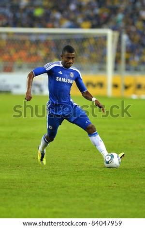KUALA LUMPUR, July 21 : Chelsea's Salomon Kalou (blue) in action during a preseason match agains Malaysia on July 21, 2011 in Kuala Lumpur, Malaysia. Chelsea won 1-0 - stock photo