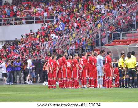 KUALA LUMPUR - JULY 16 : Liverpool football club players line up before start of the match against Malaysia XI on July 16, 2011 in Kuala Lumpur, Malaysia. Liverpool won 6-3. - stock photo