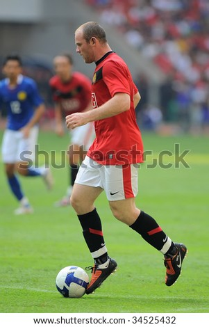 KUALA LUMPUR - JULY 18 : Wayne Rooney of Manchester United team in action during friendly match against Malaysia at National Stadium, July 18, 2009 in Kuala Lumpur.  Manchester won 3-2. - stock photo