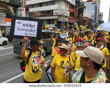 Kuala Lumpur, Malayia 29 August 2015 : Yellow shirt Supporters displaying banners supporting Bersih 4 Rally for Free Fair Elections. Bersih organized Rallies 29/30 August in cities around Malaysia  - stock photo