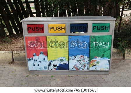 KUALA LUMPUR, MALAYSIA - April 9, 2016: a view of Collection recycle bin assorted according to color. Red for Plastic, Yellow for Cans, Blue for Paper and green for trash.   - stock photo