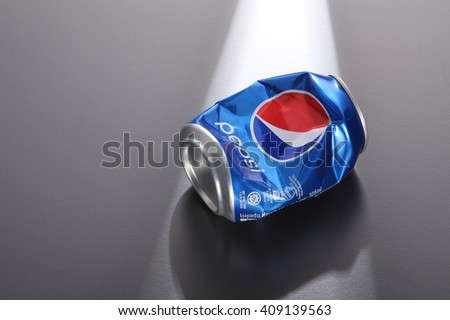 Kuala Lumpur,Malaysia -April 13 2016,crushed pepsi can on the gray background - stock photo