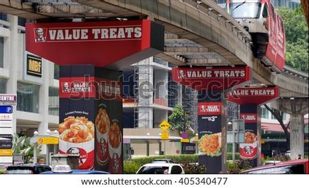 KUALA LUMPUR, MALAYSIA - April 10, 2016. KFC advertise on pillars bridge in Kuala Lumpur. KFC is a fried chicken restaurant, headquarter in Kentucky, USA.  - stock photo