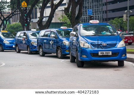 KUALA LUMPUR, MALAYSIA - APRIL 11 : Local Taxi at parking on the side road at Suria KLCC on 11 April 2016. The taxi drivers protested at the government for allowing services Grabcar & Uber to operate - stock photo
