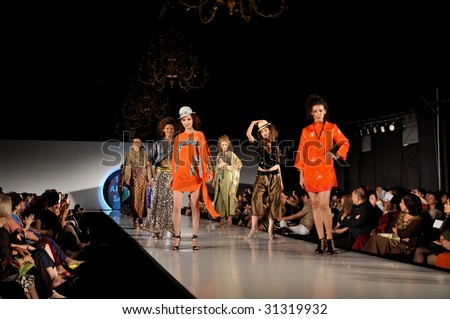 KUALA LUMPUR, MALAYSIA-APRIL 2:Models display creations by Tom Abang Saufi during STYLO Fashion Show April 2, 2009 in Kuala Lumpur.The fashion show was held in conjunction with Malaysian F1 Grand Prix - stock photo